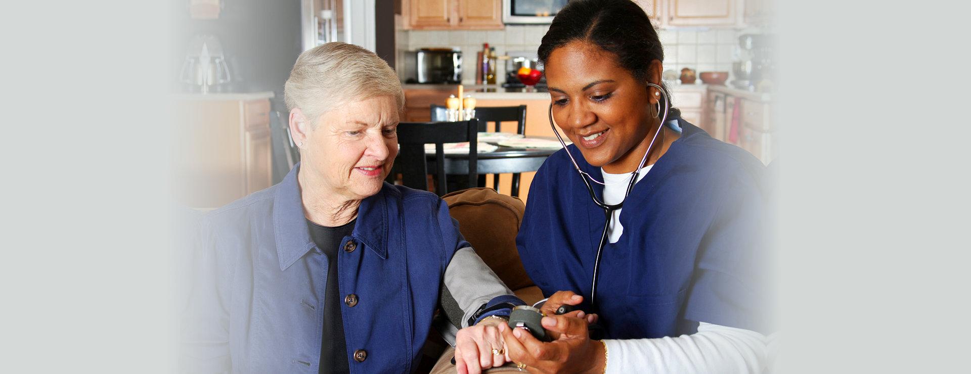 nurse checking blood pressure of her patient