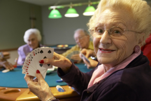 Senior adults playing bridge. Nineties, leisure